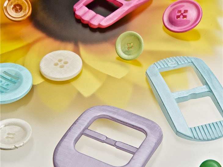 Button production for garments